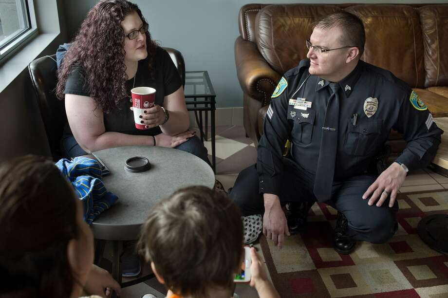"BRITTNEY LOHMILLER | blohmiller@mdn.net Midland residents from left: Genifer White, Deborah Taylor,  and Landon White, 3, talk with Midland Police Community Relations Sgt. Chris Wenzell at Coffee Chaos Thursday morning during the first Coffee with a Cop. ""I like that the cops are making themselves more accessible to the community,"" Taylor said. ""I've lived in other places and none of the police officers were as friendly as the police are here in Midland."" Photo: Brittney Lohmiller/Midland Daily News/Brittney Lohmiller"