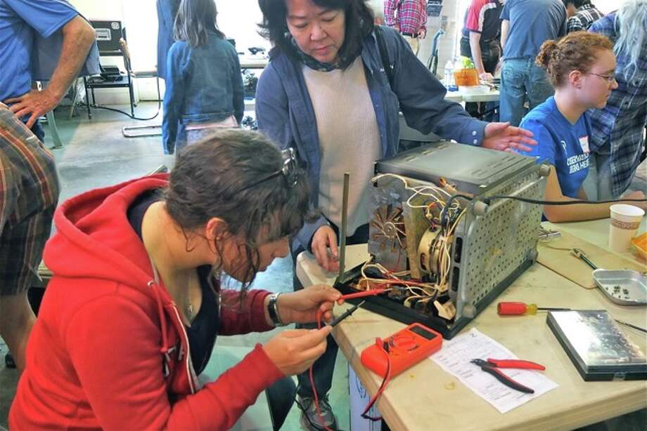 At the Repair Café in Palo Alto, people can bring their broken items and have them repaired by a team of volunteers who get a thrill out of fixing things. Photo: Courtesy Peter Skinner