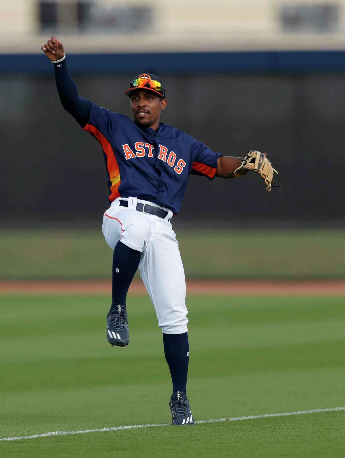 Houston Astros left fielder Tony Kemp (18) watches a ball he threw during a drill at spring training at The Ballpark of the Palm Beaches, in West Palm Beach, Florida, Thursday, February 23, 2017.