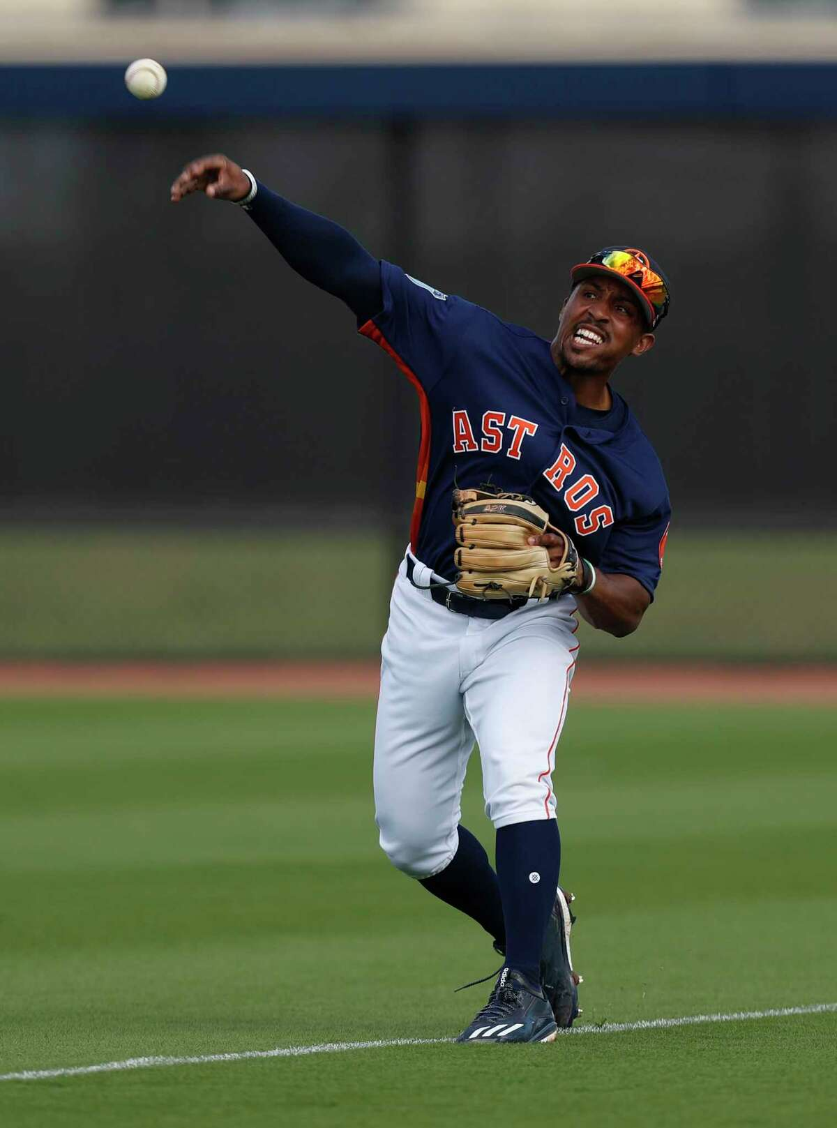 Houston Astros left fielder Tony Kemp (18) shows a ball during a drill at spring training at The Ballpark of the Palm Beaches, in West Palm Beach, Florida, Thursday, February 23, 2017.
