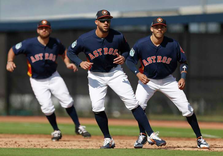 Houston Astros George Springer (4), Tyler White (13), and Carlos Correa (1) work on base running at first base together during spring training at The Ballpark of the Palm Beaches, in West Palm Beach, Florida, Thursday, February 23, 2017.