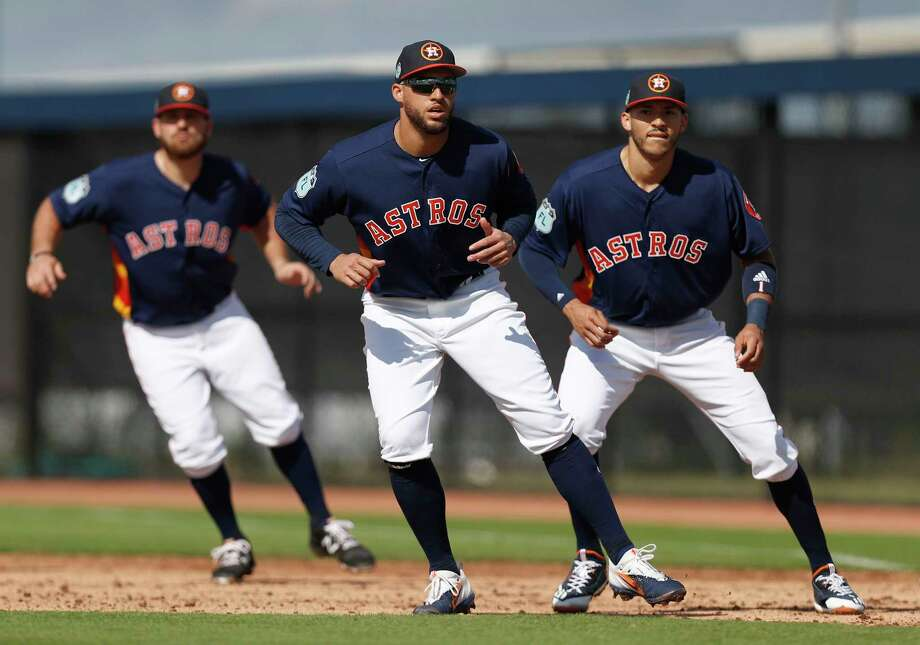 Houston Astros George Springer (4), Tyler White (13), and Carlos Correa (1) work on base running at first base together during spring training at The Ballpark of the Palm Beaches, in West Palm Beach, Florida, Thursday, February 23, 2017. Photo: Karen Warren, Houston Chronicle / 2017 Houston Chronicle