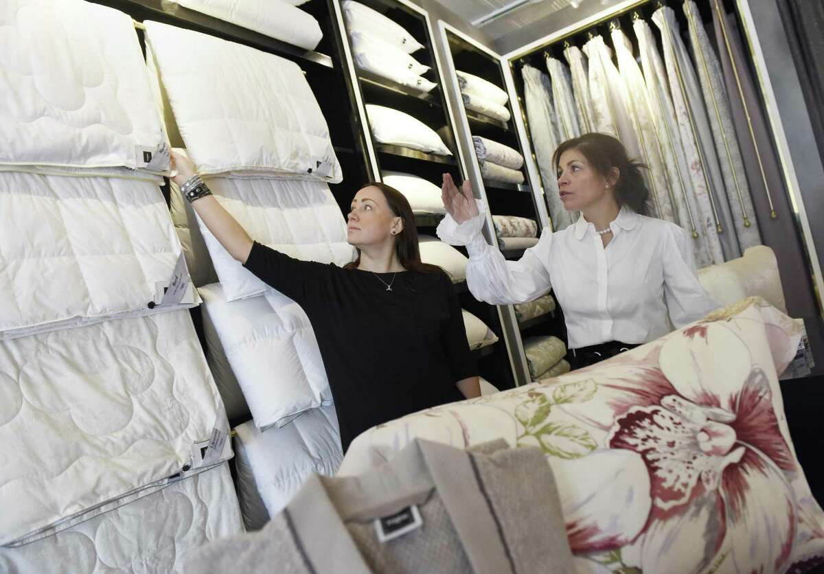 Manager of International Business Development Julia Jarray, left, and Boutique Manager Paula Davitch show a selection of duvets at Togas House of Textiles in Greenwich, Conn. Monday, Feb. 14, 2017. The Greece-based retailer is opening its first U.S. location in Greenwich, selling luxury home textiles ranging from sheets and curtains to bathrobes and towels.