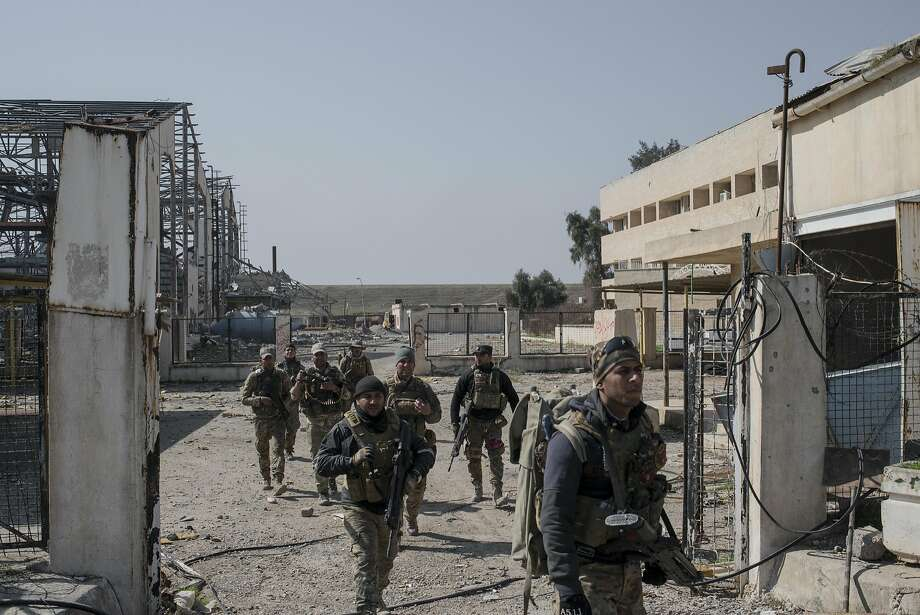 Iraqi troops advance on the Islamic State-occupied Mosul Airport as part of the effort to retake the city. Photo: Martyn Aim, Getty Images
