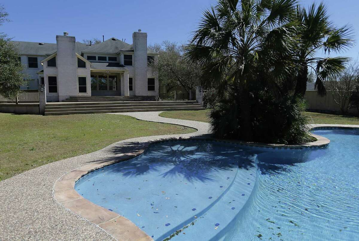 The backyard pool view of a home that was auctioned by the federal government on Thursday, Feb. 23, 2017 that belonged to the mother-in-law of former Coahuila gov. Humberto Moreira. The home Greystone home was sold to the highest bidder for $515,000. (Kin Man Hui/San Antonio Express-News)