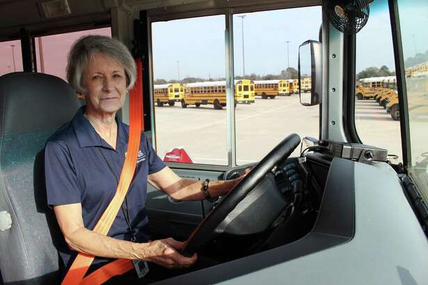 Spring ISD bus driver, Andrea Crafton, prepares to pull out of the Spring ISD Transportation Center bus lot.