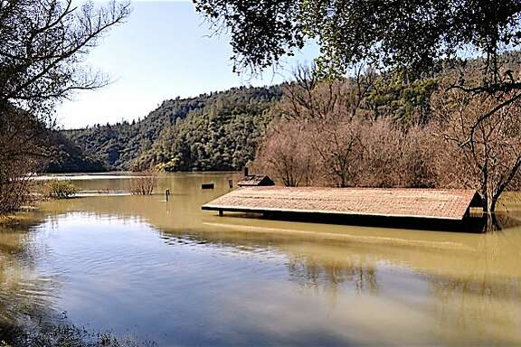 The shade roof for a picnic site along Englebright Lake is under 10 feet of water as the Yuba River flooded the lake and its boat-campsites