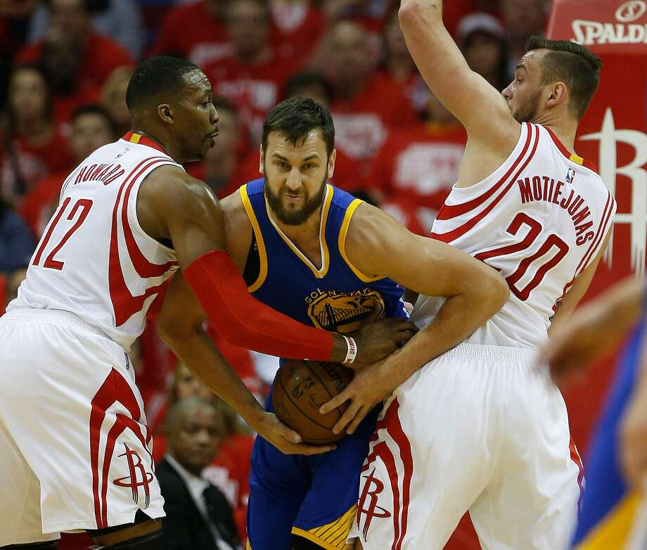 Golden State Warriors center Andrew Bogut (12) battles against Houston Rockets center Dwight Howard (12) and  Donatas Motiejunas (20) during the first half of game four of the first round of the NBA playoff series at Toyota Center, Sunday, April 24, 2016, in Houston. ( Karen Warren  / Houston Chronicle ) Photo: Karen Warren, Houston Chronicle