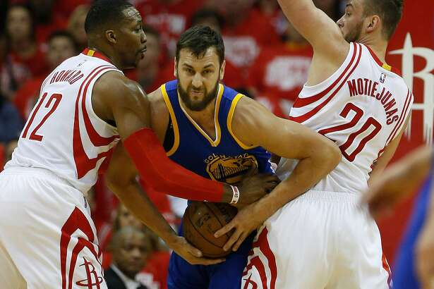 Golden State Warriors center Andrew Bogut (12) battles against Houston Rockets center Dwight Howard (12) and  Donatas Motiejunas (20) during the first half of game four of the first round of the NBA playoff series at Toyota Center, Sunday, April 24, 2016, in Houston. ( Karen Warren  / Houston Chronicle )