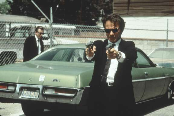 "From the film ""Reservoir Dogs"" featuring Harvey Keitel (with guns).  A Miramax Film directed by Quentin Tarantino."