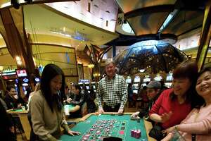 Visitors to the Mohegan Sun casino play roulette in Uncasville, Connecticut, in this file photo. The Mohegan and Mashantucket Pequots, who own Foxwoods, have a joint venture to building a satellite casino north of Hartford.