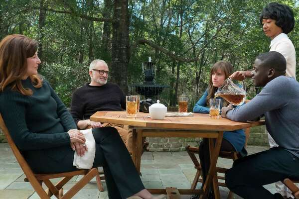 """This image released by Universal Pictures shows, from left, Catherine Keener, Bradley Whitford,  Allison Williams, Betty Gabriel and Daniel Kaluuya in a scene from, """"Get Out."""" (Justin Lubin/Universal Pictures via AP) ORG XMIT: NYET855"""