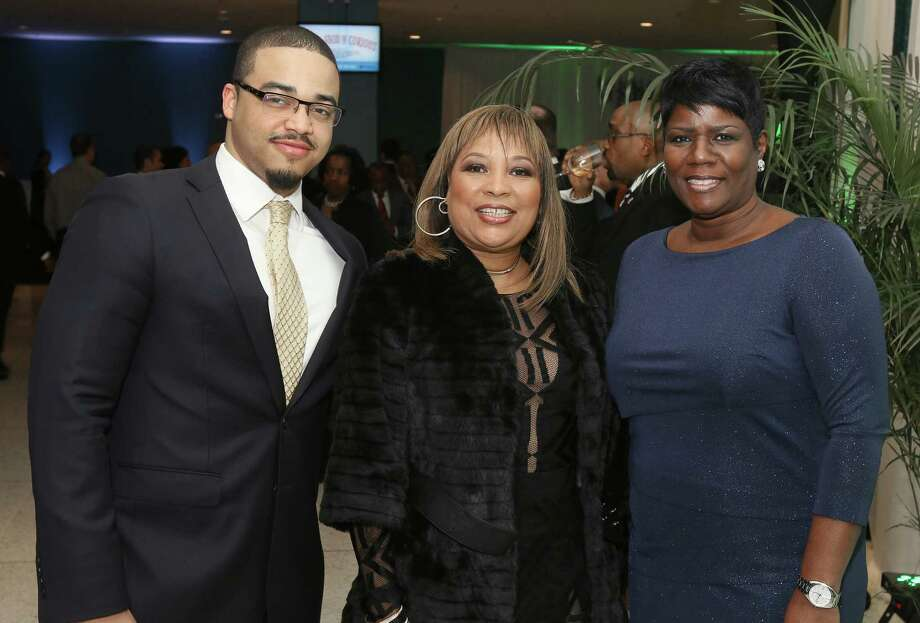 Albany, NY - February 19, 2017 - (Photo by Joe Putrock/Special to the Times Union) - Assemblywoman Pamela Harris(center) poses with Luis Mota(left) and Yvette Watts(right) during the New York State Black & Puerto Rican Caucus gala at the Empire State Plaza Convention Center. ORG XMIT: 10 Photo: Joe Putrock / Joe Putrock