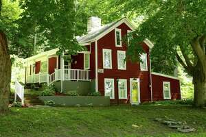 An antique farmhouse at 9 Chestnut Tree Hill Road, Extension, in Oxford dates back to 1770. The quaint two-bedroom offers several classic touches, including three working fireplaces, wideboard floors, beams and a windowed porch. It also offers a view of a nearby brook.