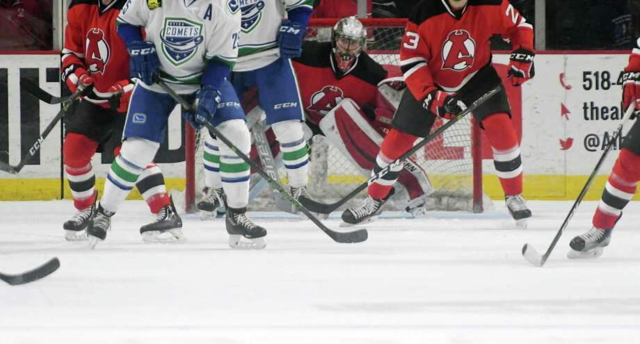 Albany Devils goalie Mackenzie Blackwood tries to keep his eyes on the puck during their game against the Utica Comets on Monday, Feb. 20, 2017, in Albany, N.Y.   (Paul Buckowski / Times Union) ORG XMIT: MER2017022016080673 Photo: PAUL BUCKOWSKI / 20039355A