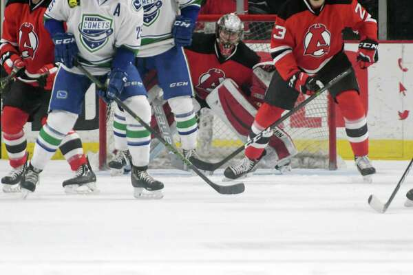Albany Devils goalie Mackenzie Blackwood tries to keep his eyes on the puck during their game against the Utica Comets on Monday, Feb. 20, 2017, in Albany, N.Y.   (Paul Buckowski / Times Union) ORG XMIT: MER2017022016080673
