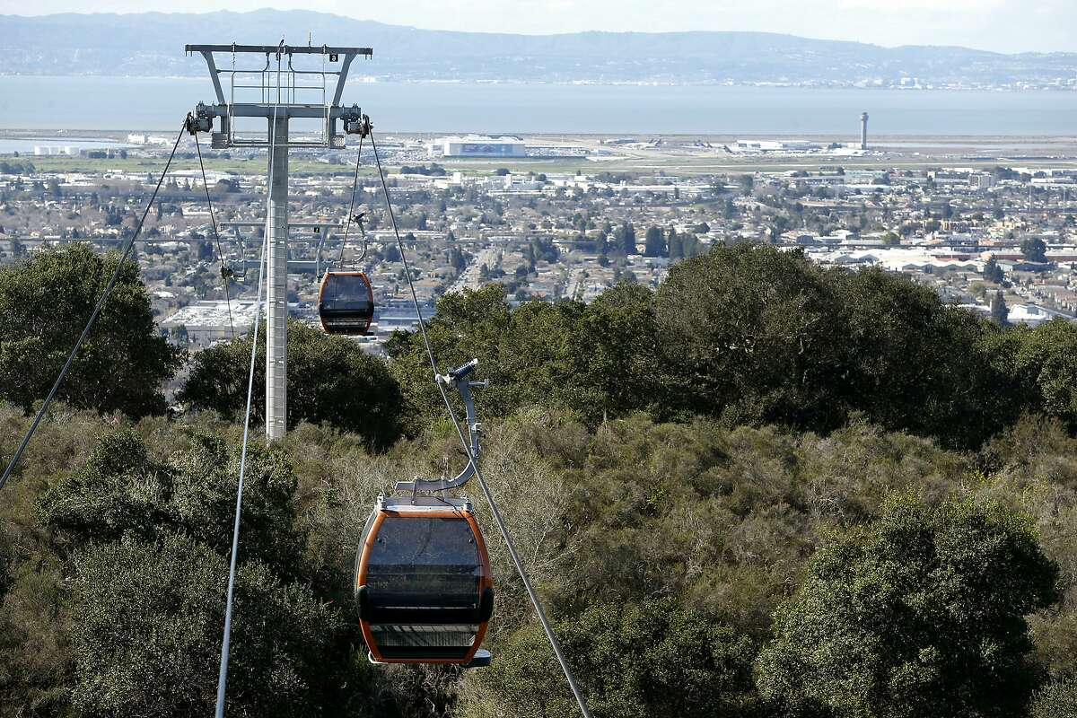 Cabins are installed on the cable of a gondola system that will carry visitors to the Oakland Zoo's new California Trail exhibit in Oakland, Calif. on Thursday, Feb. 23, 2017. The gondola and restaurant, with a sweeping view of the Bay Area, is scheduled to open in June of this year with the entire exhibit inhabited with native California creatures slated to open in 2018.