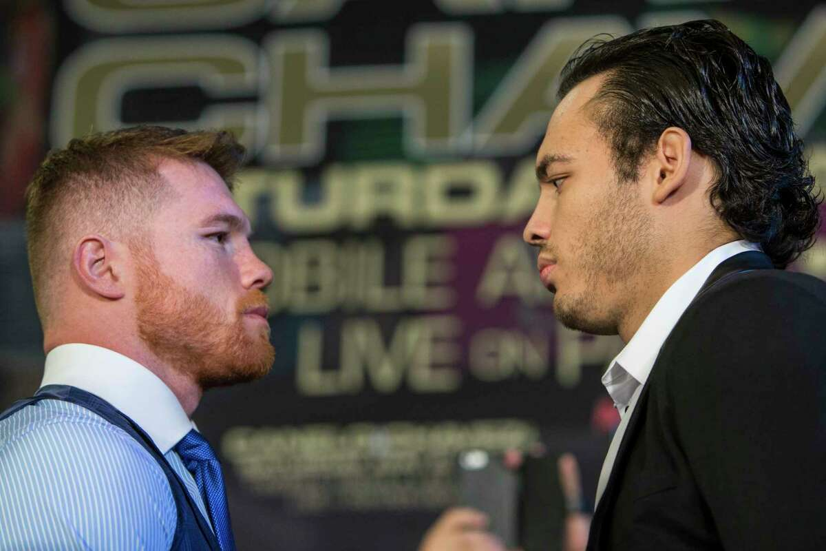 Canelo Alvarez, left, and Julio Cesar Chavez, Jr., face off as they are introduced during a news conference promoting the fight between Alvarez and Chavez at Minute Maid Park on Thursday, Feb. 23, 2017, in Houston. The Mexican boxers are scheduled to fight on May 6, 2017, at T-Mobile Arena in Las Vegas.