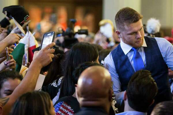 Canelo Alvarez, right, signs autographs following an event promoting the fight between Avlarez and Julio Cesar Chavez, Jr., at Minute Maid Park on Thursday, Feb. 23, 2017, in Houston. The Mexican boxers are scheduled to fight on May 6, 2017, at T-Mobile Arena in Las Vegas.
