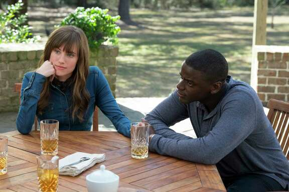 "Allison Williams, left, and Daniel Kaluuya star in ""Get Out."""
