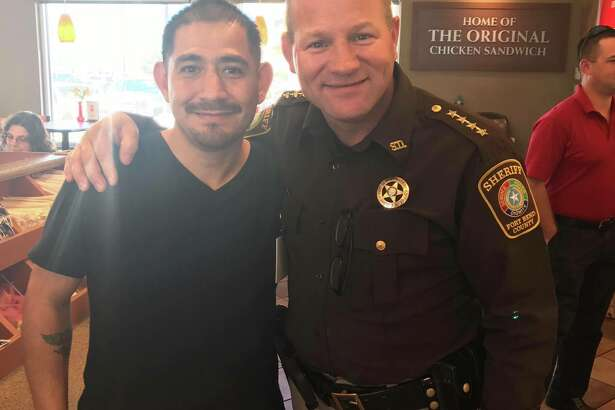 Louis Palacios, left, said Thursday that he is grateful to Sheriff Troy Nehls, who used the Heimlich maneuver to save Palacios from choking at the Rosenberg Chick-Fil-A on Feb. 22.