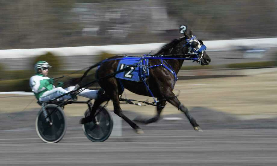 Mimosa Party driven by Pat Curtin, the eventual winner of the first race on the card at the Saratoga Hotel Casino's harness racing track warms up in the unseasonably warm weather Thursday Feb. 23, 2017 in Saratoga Springs, N.Y.  (Skip Dickstein/Times Union) Photo: SKIP DICKSTEIN / 40039744A