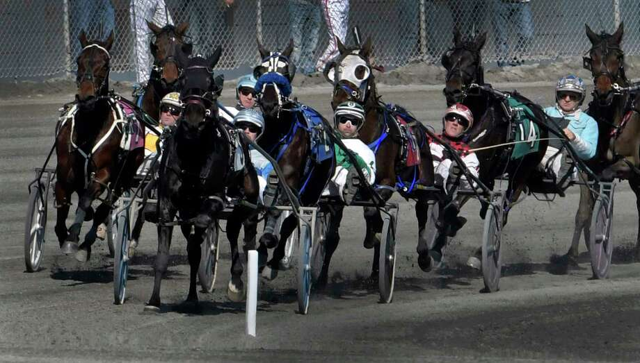 All the drivers are concentrating on the finish as the field makes the top of the stretch during the first race on the card at the Saratoga Hotel Casino's harness track on an unseasonably warm day Thursday Feb. 23, 2017 in Saratoga Springs, N.Y.  (Skip Dickstein/Times Union) Photo: SKIP DICKSTEIN / 40039744A