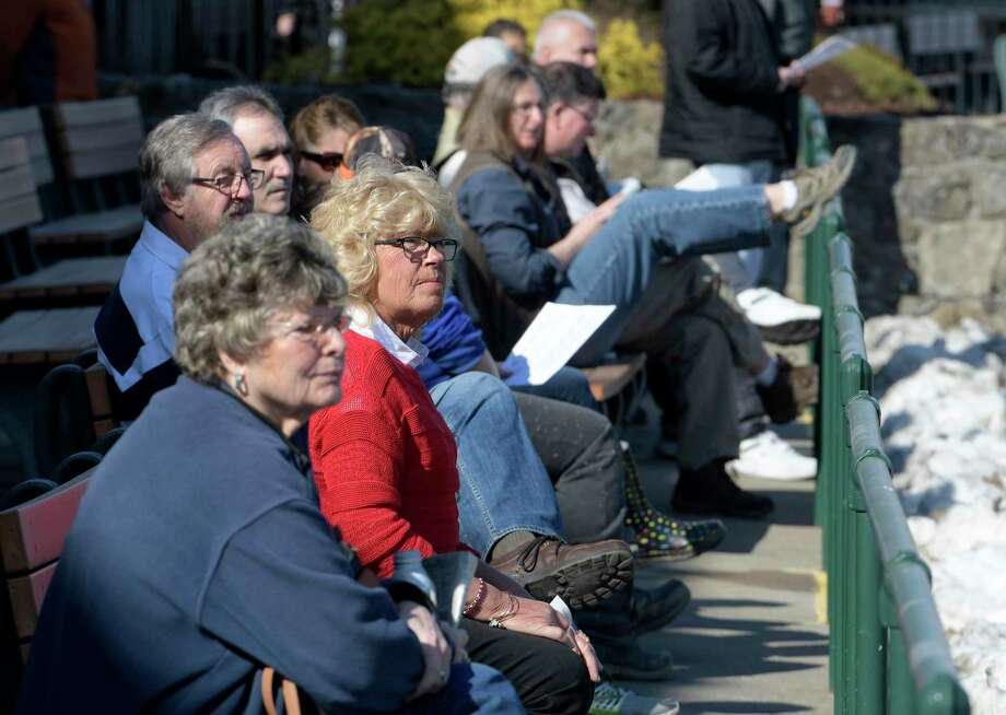 Fans enjoy the warm weather and the racing  during the race card at the Saratoga Hotel Casino's harness track Thursday Feb. 23, 2017 in Saratoga Springs, N.Y.  (Skip Dickstein/Times Union) Photo: SKIP DICKSTEIN / 40039744A