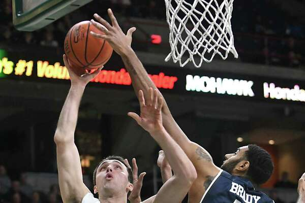 Siena's Brett Bisping is defended by Monmouth's Chris Brady as he makes a move to the basket during a basketball game at the Times Union Center on Monday, Feb. 13, 2017 in Albany, N.Y. (Lori Van Buren / Times Union)