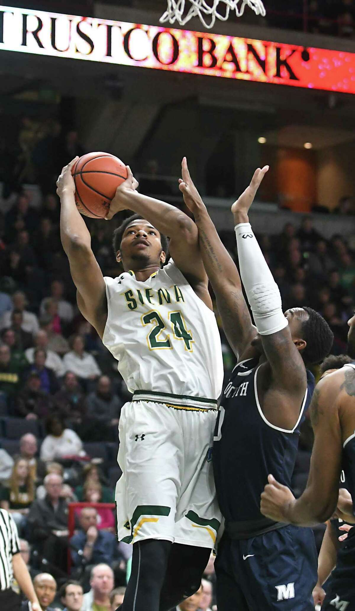 Siena's Lavon Long drives to the hoop during a basketball game against Monmouth at the Times Union Center on Monday, Feb. 13, 2017 in Albany, N.Y. (Lori Van Buren / Times Union)