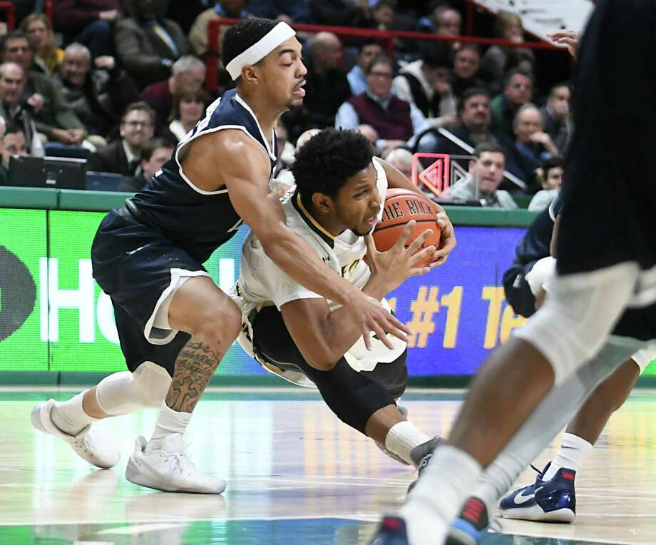 Siena's Lavon Long slips as he tries to make a move around Monmouth's Justin Robinson during a basketball game at the Times Union Center on Monday, Feb. 13, 2017 in Albany, N.Y. (Lori Van Buren / Times Union) Photo: Lori Van Buren / 20039395A