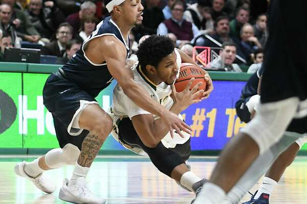 Siena's Lavon Long slips as he tries to make a move around Monmouth's Justin Robinson during a basketball game at the Times Union Center on Monday, Feb. 13, 2017 in Albany, N.Y. (Lori Van Buren / Times Union)