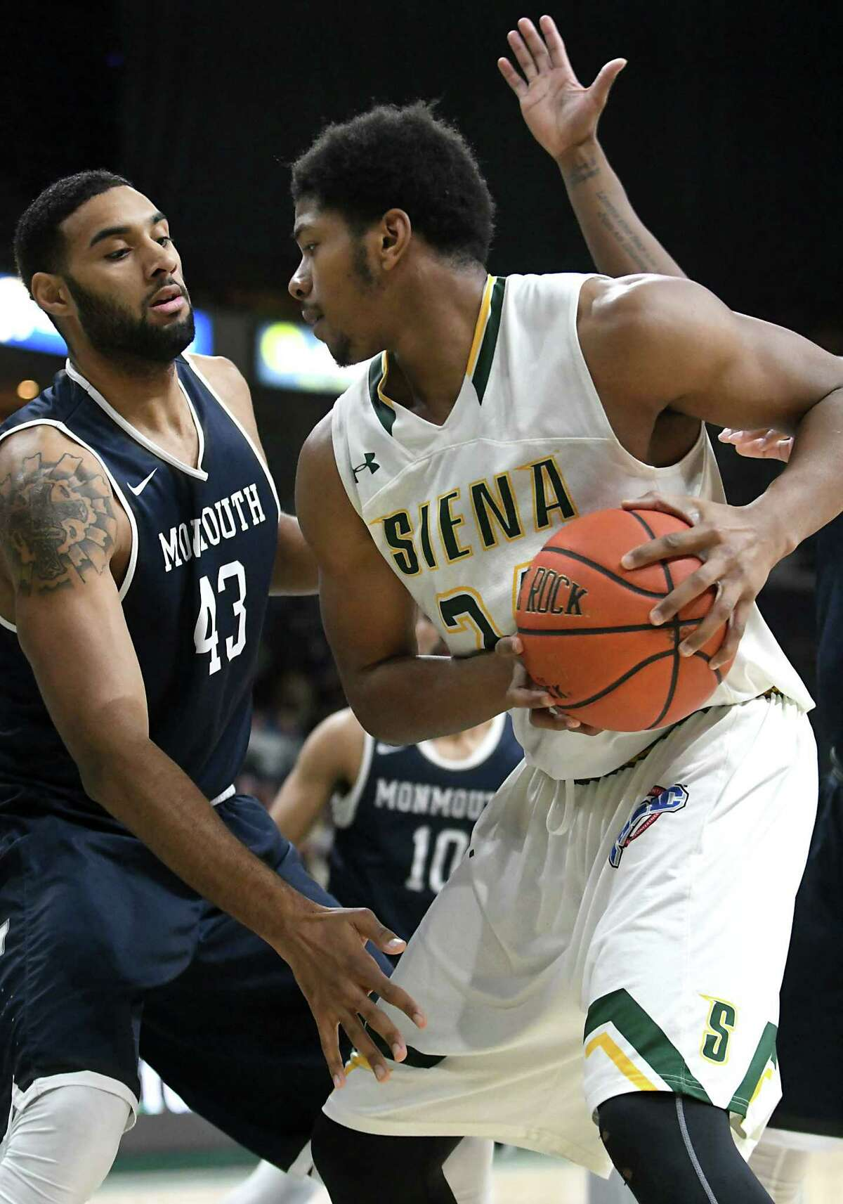 Siena's Lavon Long is defended by Monmouth's Chris Brady as he tries to make a move to the basket during a basketball game at the Times Union Center on Monday, Feb. 13, 2017 in Albany, N.Y. (Lori Van Buren / Times Union)