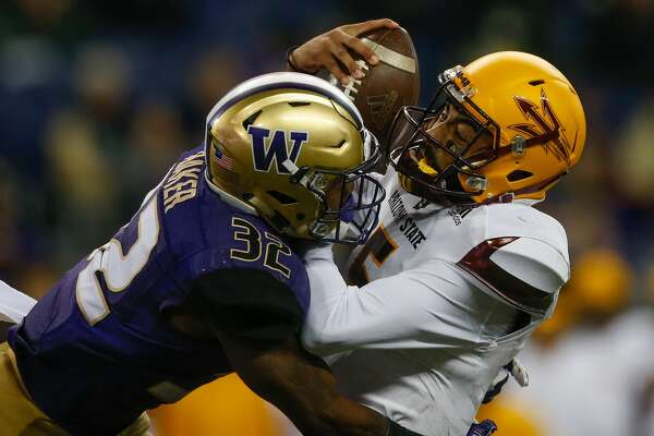 SEATTLE, WA - NOVEMBER 19:  Quarterback Manny Wilkins #5 of the Arizona State Sun Devils is sacked by defensive back Budda Baker #32 of the Washington Huskies on November 19, 2016 at Husky Stadium in Seattle, Washington. The Huskies defeated the Sun Devils 44-18.  (Photo by Otto Greule Jr/Getty Images)