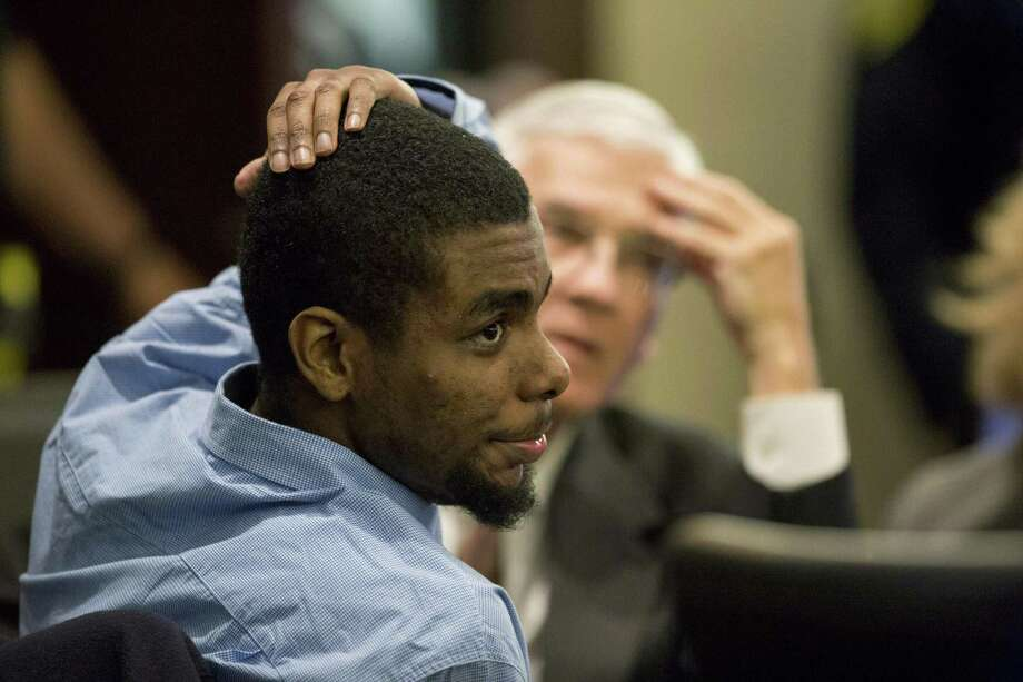 \ Darnell Rogers reacts after he was convicted of aggravated assault at Bexar County 227th Criminal District Court in San Antonio, Texas on February 22, 2017. Ray Whitehouse / for the San Antonio Express-News Photo: Ray Whitehouse /For The San Antonio Express-News