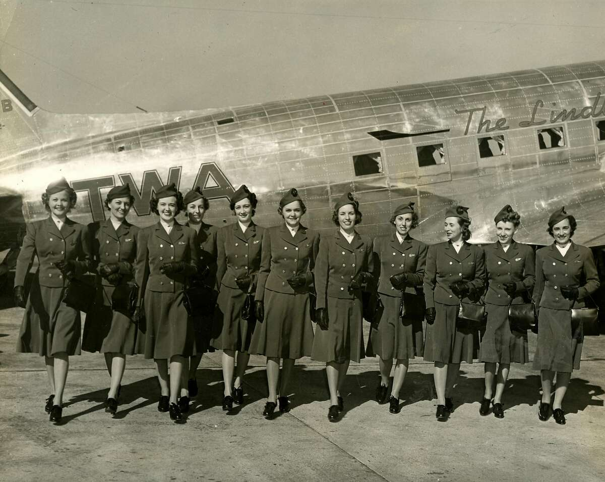 New blue stewardess uniforms, September 30, 1939. Left to right are, Katie Wilson, Miss American Aviation for 1939, Mia J. Hill, Alga Harbaugh, Anita Loos, D. David, J. Staggers, Lois Peak, L. Canaday, M. Clark, D. Meagher, G Entrekin. It says