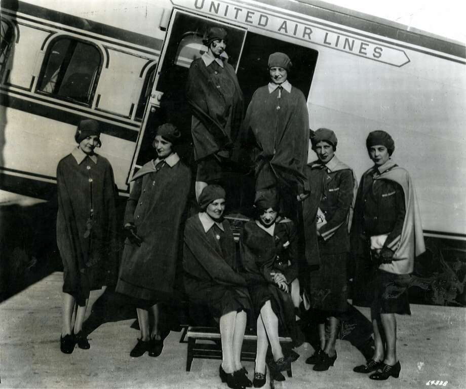 """Caption from the archive photo:""""It was May 15, 1930, when  these young  nurses assembled beside an old Boeing transport, ready to make  aviation history as the first airline stewardesses. About 35,000 stewardesses, no longer required to be registered nurses, fly for U.S. domestic airlines today (1970). Left to right are, Margaret Arnott, Inez Keller, Cornelia Peterman, Harriet Iden, Jessie Carter, Ella Crawford, and (in doorway from left) Ellen church and Alva Johnson. They flew the San Francisco to Chicago route."""" The plane says United Airlines. Photo courtesy of AP May 14, 1970"""