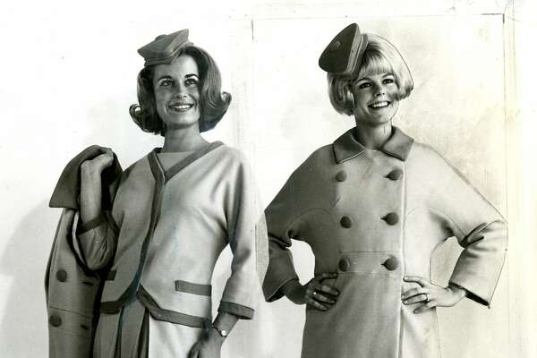 Charlyn Helsel, left, wears dress with jacket and holds coat tat is identical to the one worn by Judy Bailey, right. December 5, 1966