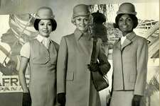 "From the photo: New uniforms for the stewardesses of Pan American Airways consist of two distinct outfits, a beige jumper and a blue skirt, each with matching jacket and white, vest-type blouse, plus bowler hat and a blue greatcoat in  the   classic Chesterfield style. The new look in uniforms, which Pan Am will introduce on Easter Sunday, was inspired by the 362 passenger 747 Superjet which the airline will introduce late in 1969.""  The colors were pale gold and champagne. Photo courtesy Pan Am March 12, 1969"