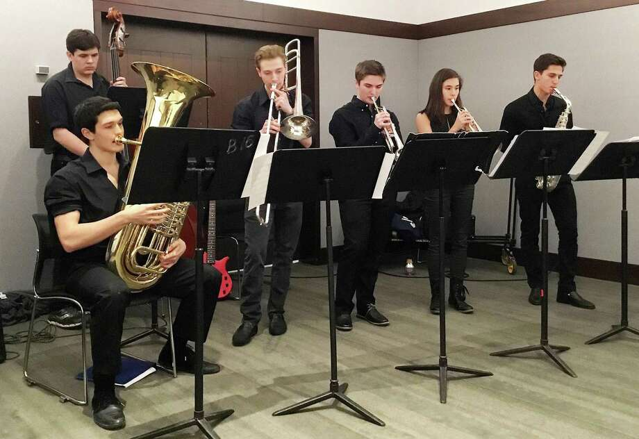 New Canaan resident Luke Koppenheffer, center, plays the trumpet in the King School Jazz Studio Orchestra. The junior's musical group placed 9th out of 16 in their division at the Berklee College of Music's Jazz Festival Feb. 10-12 in Boston, Mass. Photo: Contributed Photo / New Canaan News