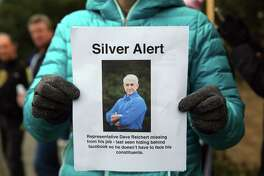 Protesters gather outside Rep. Dave Reichert's (R-WA) office in Issaquah Thursday, Feb. 23, 2017. Some of Reichert's constituents in the 8th District say he is avoiding them by skipping Town Hall meetings and refusing phone calls.