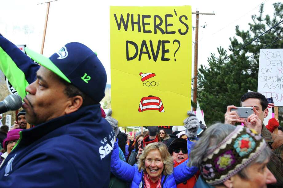 Protesters gather outside Rep. Dave Reichert's (R-WA) office in Issaquah Thursday, Feb. 23, 2017. Some of Reichert's constituents in the 8th District say he is avoiding them by skipping Town Hall meetings and refusing phone calls. Photo: GENNA MARTIN, SEATTLEPI.COM / SEATTLEPI.COM