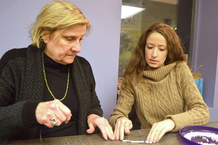 Mother-daughter team, Sue and Diana Galati, both of Westport, pitch in for charity for the bracelet-assembly project to benefit Stamford-based Pacific House, held at Art & Soul Feb. 16 in New Canaan, Conn. Photo: Jarret Liotta / For Hearst Connecticut Media / New Canaan News Freelance
