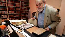 Bexar County Clerk Gerry Rickhoff reviews James Bowie documents in the vault in the Spanish Archives at the Courthouse. He and County Judge Nelson Wolff are trying to obtain artifacts regarding Bexar County colonial days from UT. A reader says they should stay in Austin.