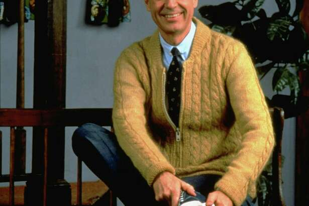 """The temperate words of Fred Rogers, shown on the set of """"Mister Rogers' Neighborhood"""" in   1996,   contrast with the man we've elected president. Trumpism lashes out at the outside world with fear and suspicion. Rogers embraced it."""
