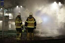 Fire fighters in the suburb Rinkeby outside Stockholm, Feb. 20. Swedish police on Tuesday were investigating a riot that broke out overnight in a predominantly immigrant suburb in Stockholm after officers arrested a suspect on drug charges. The clashes underscore the difficulty in assimilating migrants.
