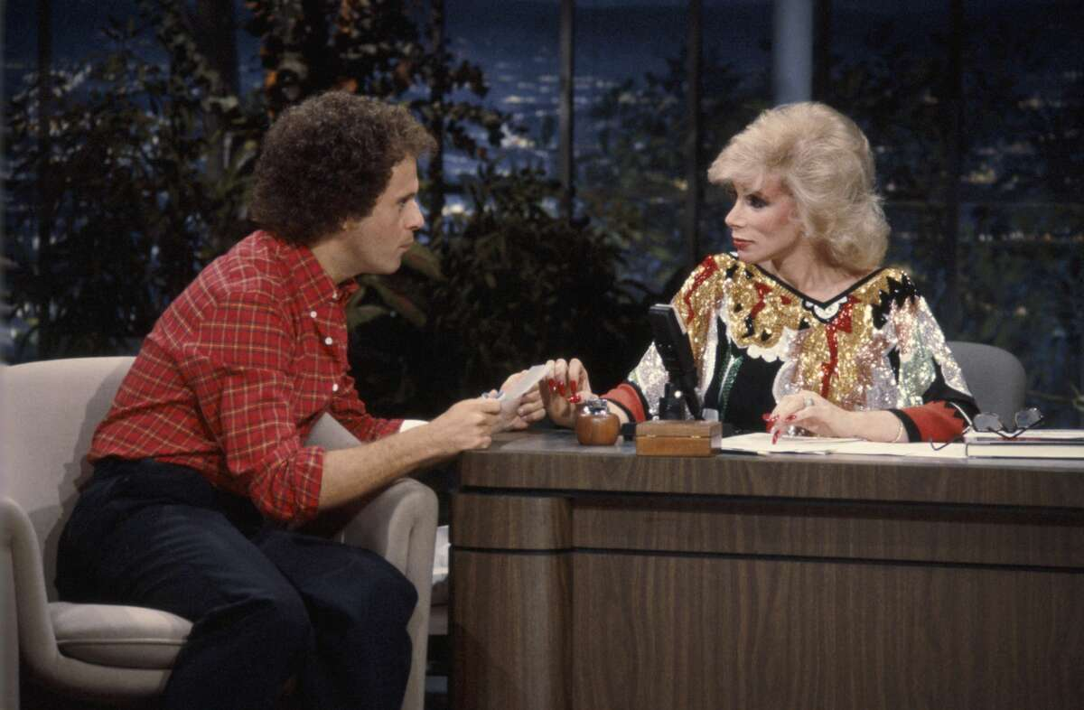 Fitness expert Richard Simmons and guest host Joan Rivers on