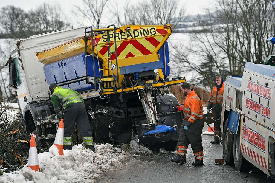 BALFRON, SCOTLAND - FEBRUARY 23:  Men recover an overturned gritting lorry near Balfron Station on February 23, 2017 in Balfron, Scotland. Travel disruption is affecting many parts of Scotland as Storm Doris arrived. The Met Office has issued an amber weather warning for snow for large parts of the country.  (Photo by Jeff J Mitchell/Getty Images) *** BESTPIX *** Photo: Jeff J Mitchell