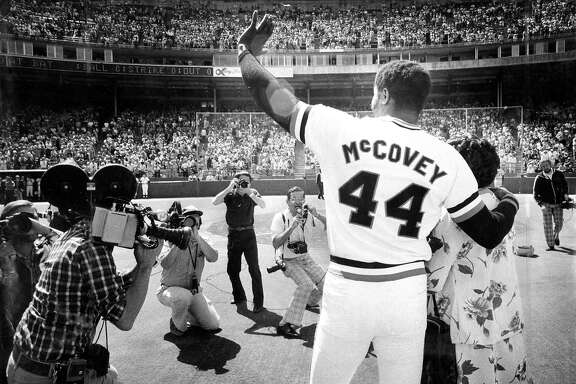 Sept. 18, 1977: Giants first baseman Willie McCovey waves to fans as he's honored at Candlestick Park in 1977. His arm is around his mother Esther's shoulder.
