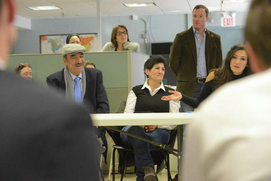 Diab Tabouni, 70, sits with his wife, Souad Wanle, 65, as their daughter Allaa Tabouni interprets a question they ask to Sen. Chris Murphy and Rep. Jim Himes during a visit with immigrants at Building One Community in Stamford on Thursday. Photo: Matthew Brown / Hearst Connecticut Media / Stamford Advocate